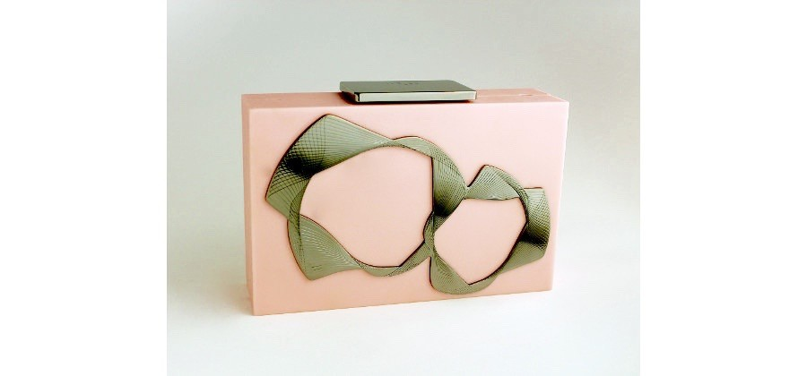 Clutch in plexiglass processed for having a pink suede effect ; a black brass is applied; please wait, it will be soon available online